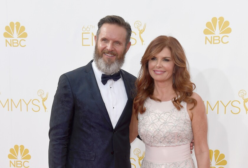 "MGM CEO Gary Barber said it made sense to revive the United Artists name for use in conjunction with Mark Burnett and Roma Downey, above at the Emmy Awards, because partnering with them offers the chance at ""another terrific success story to build value in the brand again."""