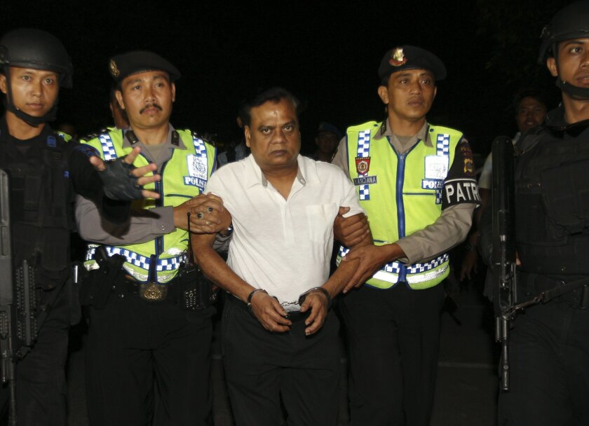 """Indian fugitive Rajendra Sadashiv Nikalje, known in India as """"Chotta Rajan,"""" center, is escorted by police officers to the Bali airport to be deported, Indonesia, Thursday, Nov. 5, 2015. The alleged organized crime boss, wanted for alleged involvement in several mafia killings and other major crime"""