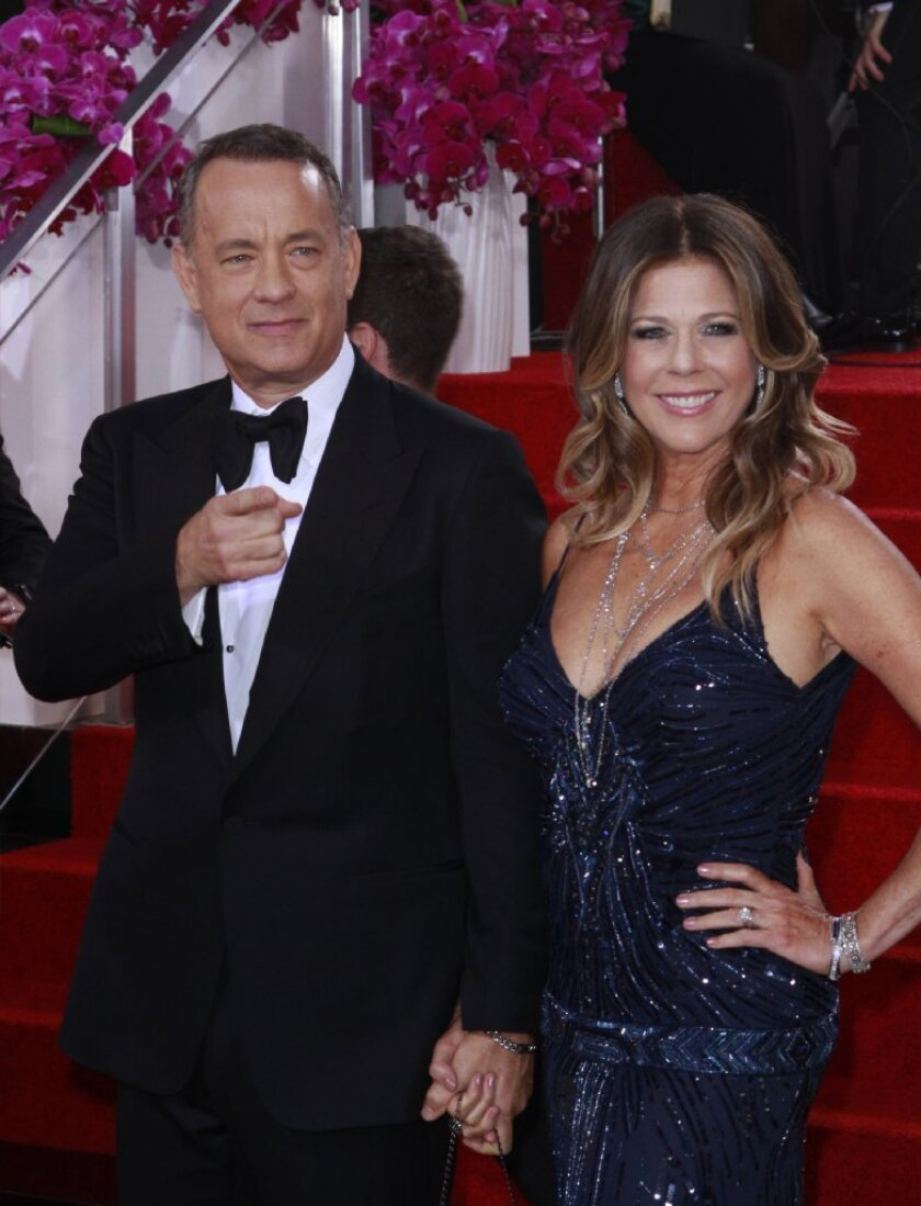 Tom Hanks and Rita Wilson arrive for the 71st Annual Golden Globe Awards show at the Beverly Hilton Hotel on Jan. 12, 2014.