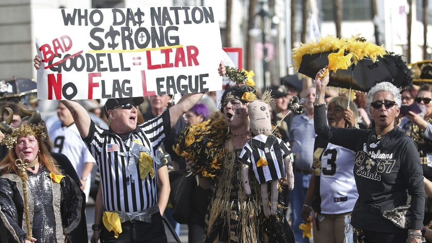 Saints fans make their way down Canal Street on Super Bowl Sunday.