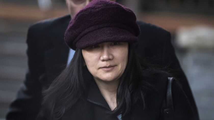 FILE- In this Jan. 29, 2019, file photo, Huawei chief financial officer Meng Wanzhou leaves her home