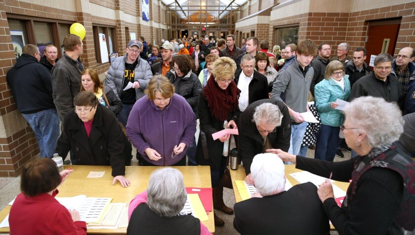 Republican voters register before taking part in caucusing at Carroll High School in Carroll, Iowa, in 2016.