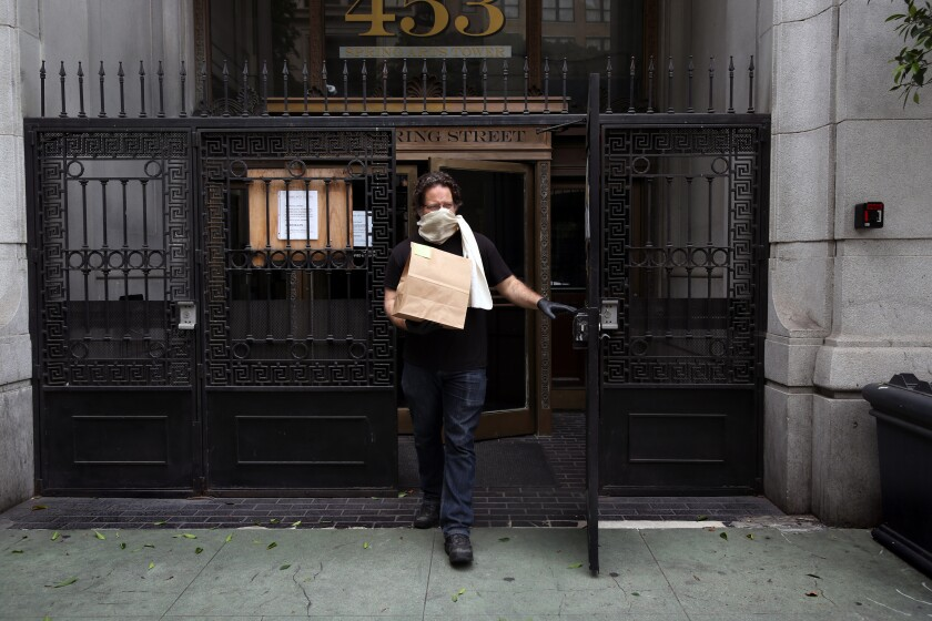 Eric Larkin steps out to deliver an order to a customer at the Last Bookstore.