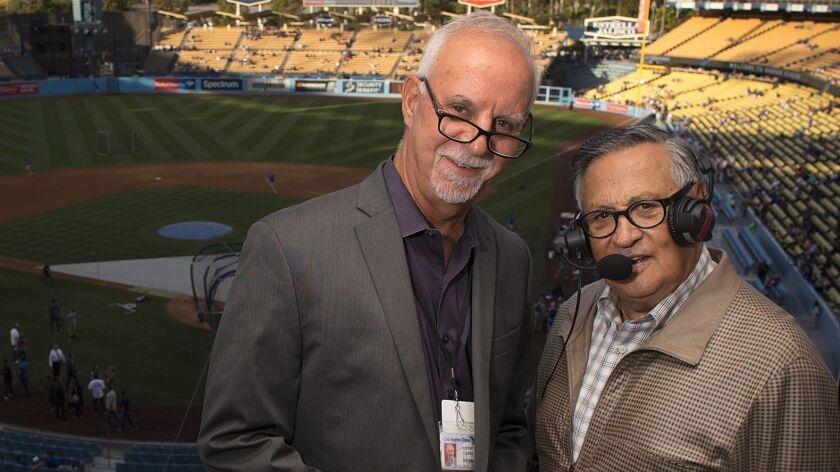 Times Columnist Steve Lopez, left, with his Spanish teacher, Dodgers broadcaster Jaime Jarrin.