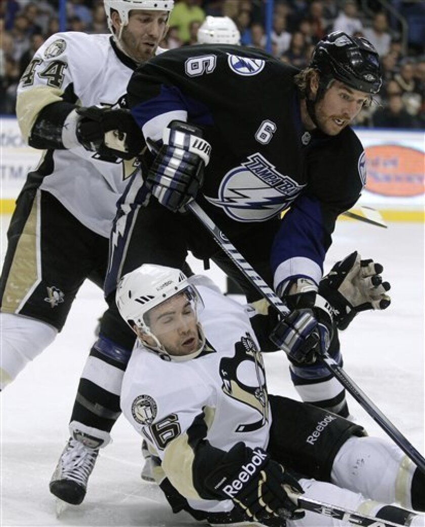 Tampa Bay Lightning left wing Ryan Malone (6) takes down Pittsburgh Penguins right wing Chris Conner (16) after getting by Penguins' Brooks Orpik (44) during the second period of an NHL hockey game Thursday, March 31, 2011 in Tampa, Fla. (AP Photo/Chris O'Meara)