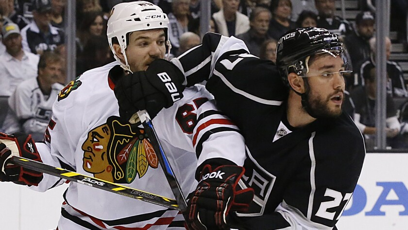 Kings defenseman Alec Martinez, right, battles with Chicago Blackhawks forward Andrew Shaw for position in front of goalie Jonathan Quick during the Kings' 5-2 win in Game 4 of the Western Conference finals Monday.
