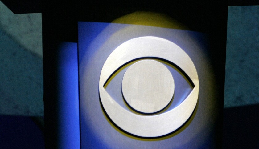 A CBS Corp. logo silhouetted in Las Vegas.