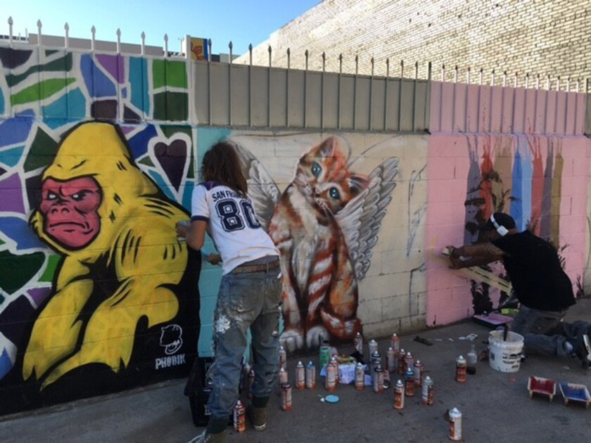 Artists work on 'Animal Alley L.A.' in Echo Park.