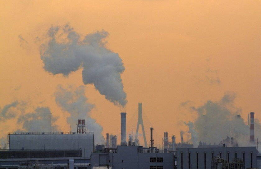 The 90 biggest producers of fuels driving climate change include investor-owned corporations, such as Exxon Mobil and Chevron, and state-owned oil companies, such as Saudi Aramco and Mexico's Pemex. Above, a plant in Tokyo.