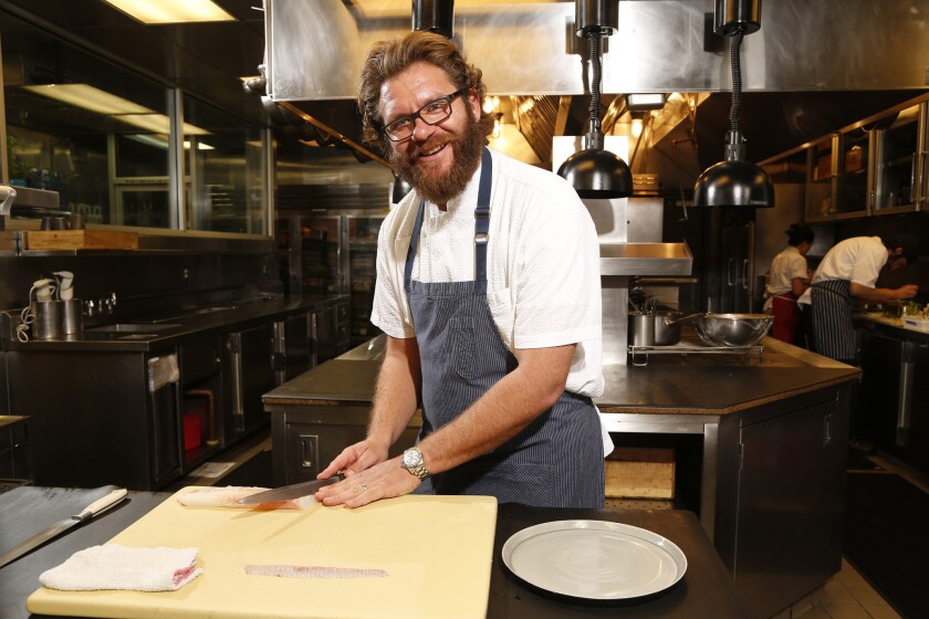 Chef Michael Cimarusti is seen in the kitchen of Providence. Cimarusti is holding a series of guest-chef dinners at Providence through October.