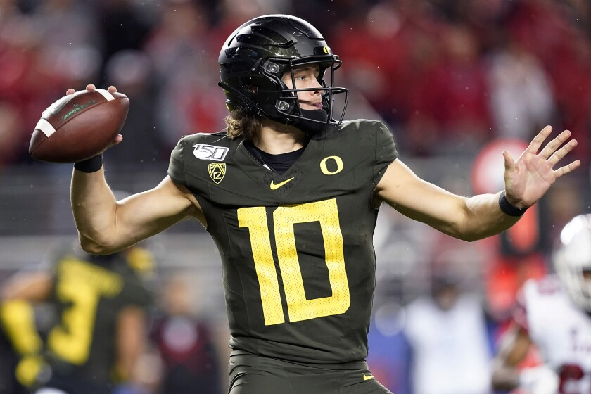 Oregon quarterback Justin Herbert throws a pass against Utah during the second half of the Pac-12 championship game in Santa Clara on Friday.