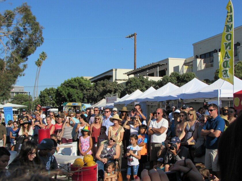La Jolla Art and Wine Festival provides entertainment, in addition to art viewing and wine tasting.