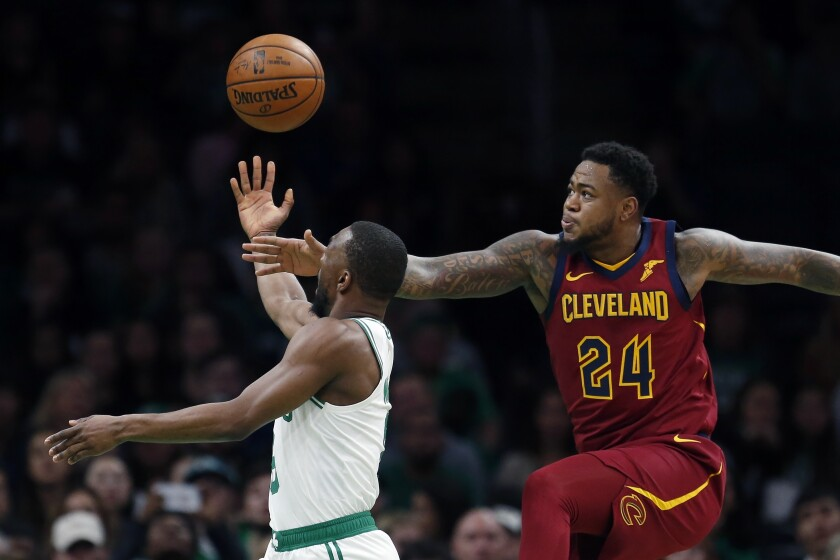 Boston Celtics' Kemba Walker, left, shoots against Cleveland Cavaliers' Jarell Martin (24) during the first half of an NBA preseason basketball game in Boston, Sunday, Oct. 13, 2019. (AP Photo/Michael Dwyer)