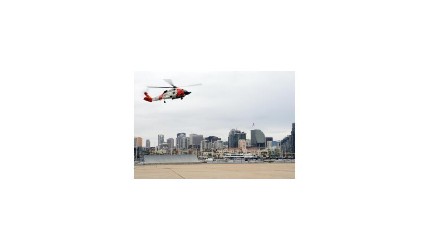 A Coast Guard helicopter returns to San Diego after rescuing a 71-year-old man suffering from a possible heart attack.