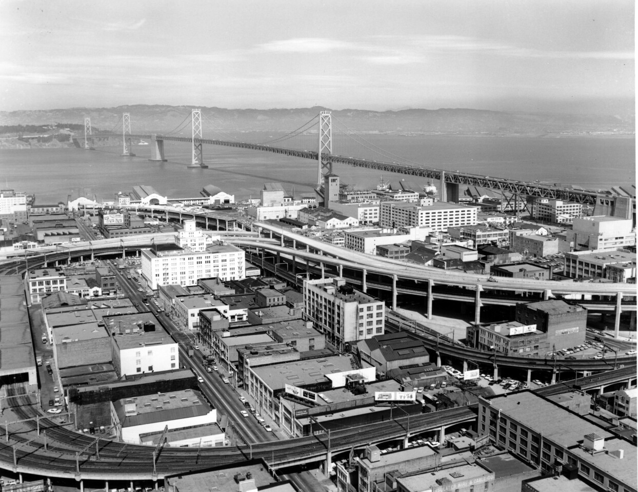 San Francisco has torn down the double-decker Embarcadero Freeway, shown in 1957, and old ramps that once connected streetcar trains from the old Transbay Terminal to the Bay Bridge. The freeway was closed after it was damaged in the 1989 Loma Prieta earthquake.