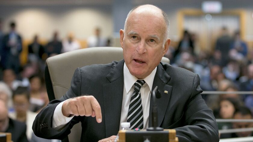 Gov. Jerry Brown responds to a question while testifying in support of extending the state's cap-and-trade program during a hearing of the Senate Environmental Quality committee.