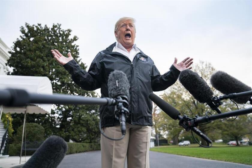US President Donald Trump speaks to the media at the White House on Saturday, Nov. 17, 2018, before flying to California, where he visited the area devastated by a giant wildfire that has been spreading in northern California since last week, and which he toured with California Gov. Jerry Brown. EFE-EPA/Jim Lo Scalzo