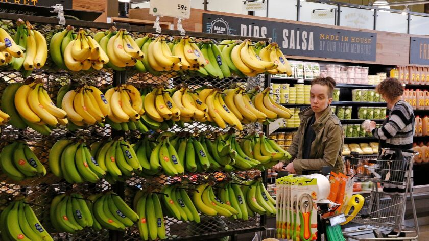 In this May 3, 2017, photo, customers shop at a Whole Foods Market in Upper Saint Clair, Pa. Amazonâ