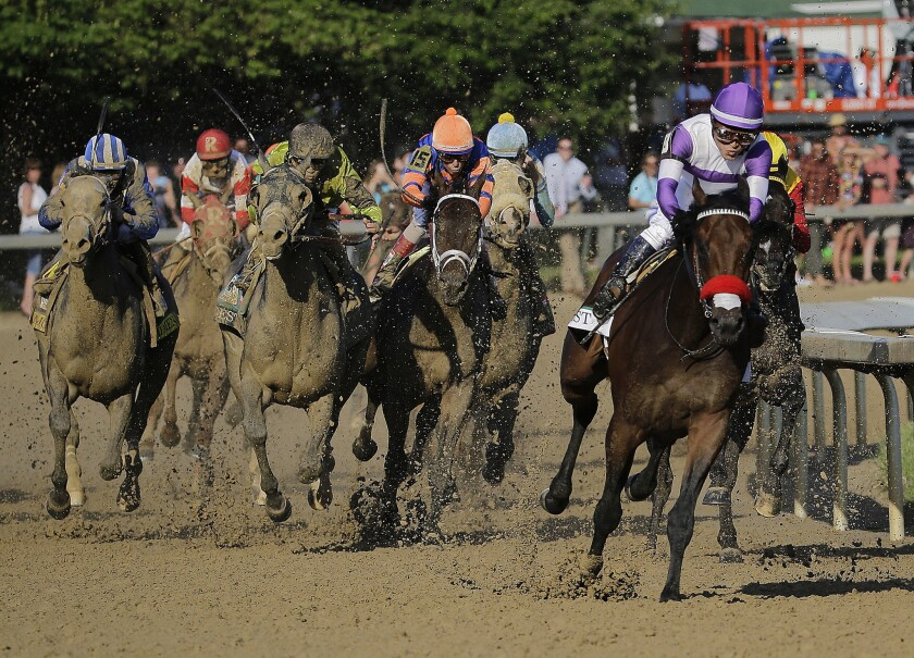 Nyquist, with Mario Gutierrez aboard, pulls away from the field at the top of the homestretch during the 142nd Kentucky Derby.