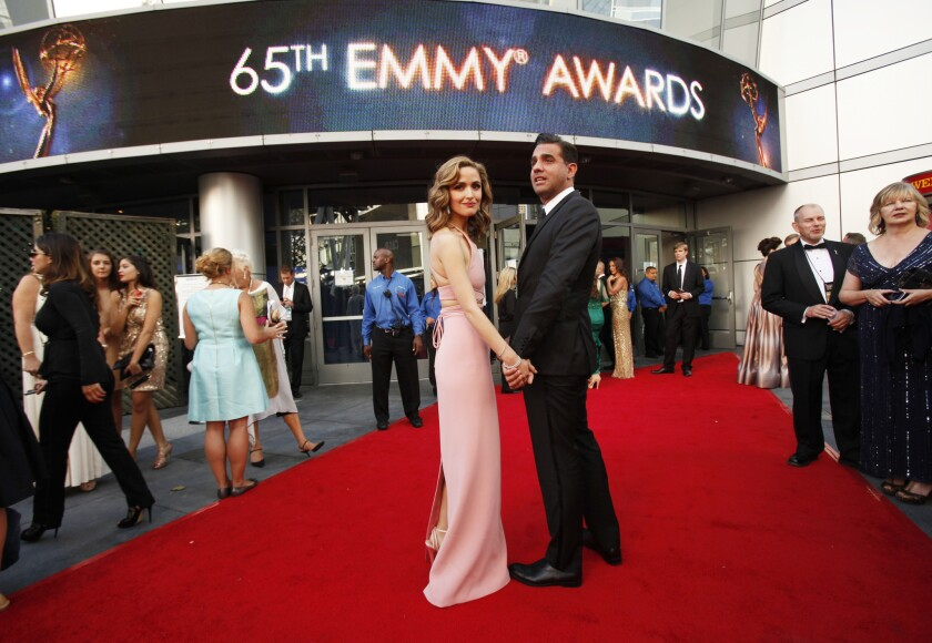 Rose Byrne and Bobby Cannavale walk the red carpet together at the 65th Primetime Emmy Awards on Sept. 22, 2013.