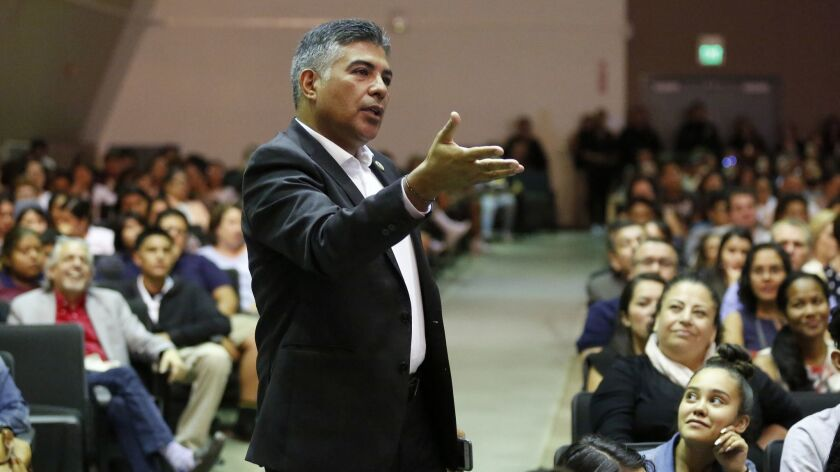 Rep. Tony Cárdenas (D-Los Angeles) asks a question during a town hall with students in Panorama City.