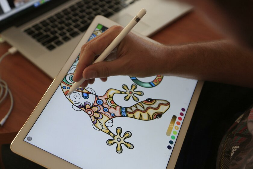 Pixite creative developer Ben Guerrette demonstrates the company's coloring book app, Pigment, on an iPad Pro with the Apple Pencil.