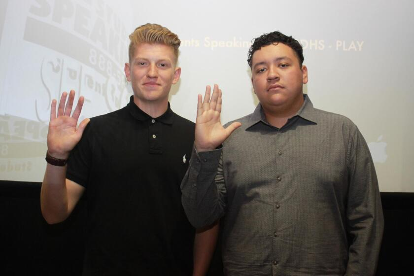 In accordance with their PSA, Point Loma High seniors (and PSA producers) Jakob Tiger and Anthony Torres, raise their right hand and promise if they see something, they will say something.