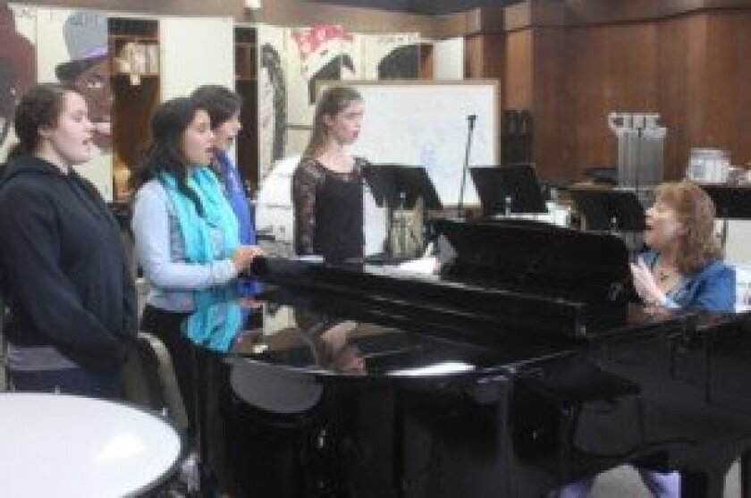 Denise Baltazar, Netcheo Bello, Sophia Woolery and Lindsay Crowe, all juniors at La Jolla high, warm up for after-school choir practice. Ashley Mackin
