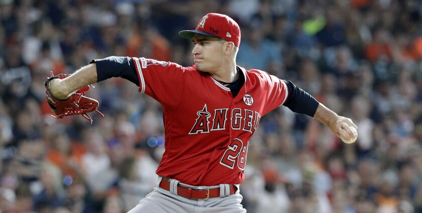 Angels starting pitcher Andrew Heaney throws against the Houston Astros on July 6.