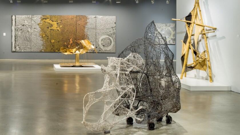 """""""Claire Falkenstein: Beyond Sculpture,"""" installation view. Foreground: """"Predator"""" (1963-64), shopping cart, wire, paint."""