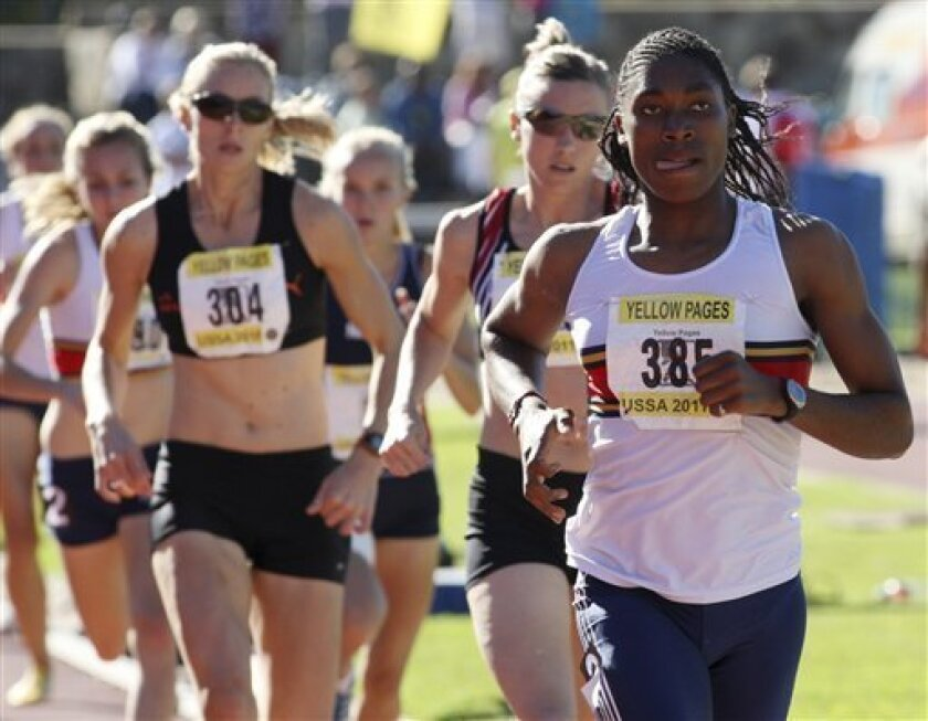South Africa's athlete Caster Semenya, right, winning the 800m final during the University Sport South Africa National Championships in Stellenbosch, South Africa, Saturday, April 30, 2011. (AP Photo)