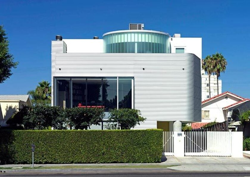 With its corrugated steel exterior and glass-curtain wall, the house stands out in a Larchmont neighborhood mostly filled with neo-traditional homes.