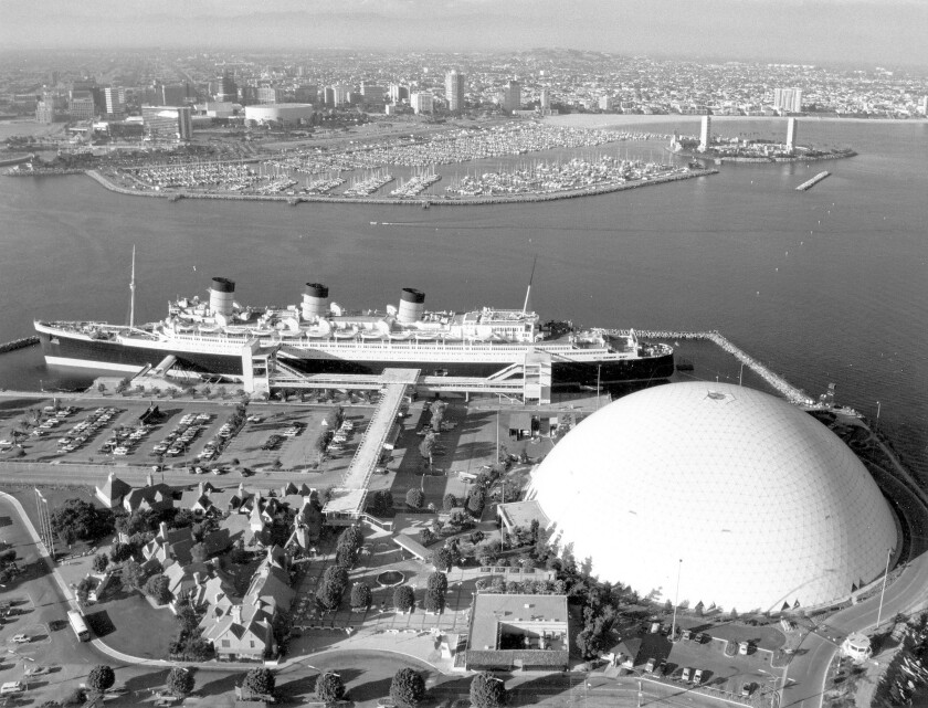 The City of Long Beach is trying to develop a large swath of vacant land surrounding the Queen Mary, shown above in 1987.