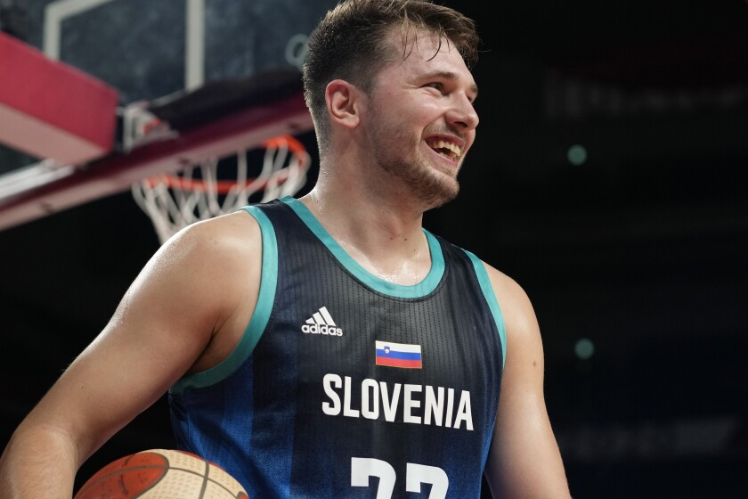 Slovenia's Luka Doncic (77) reacts to a play during a men's basketball preliminary round game against Spain at the 2020 Summer Olympics, Sunday, Aug. 1, 2021, in Saitama, Japan. (AP Photo/Eric Gay)