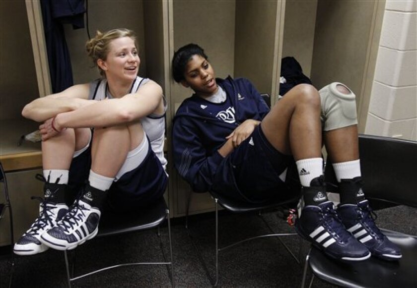 Notre Dame's Mary Forr, left, and Ariel Braker relax in the locker room before practice for the women's NCAA Final Four national championship college basketball game in Indianapolis, Monday, April 4, 2011. Texas A&M faces Notre Dame in Tuesday's game. (AP Photo/Michael Conroy)