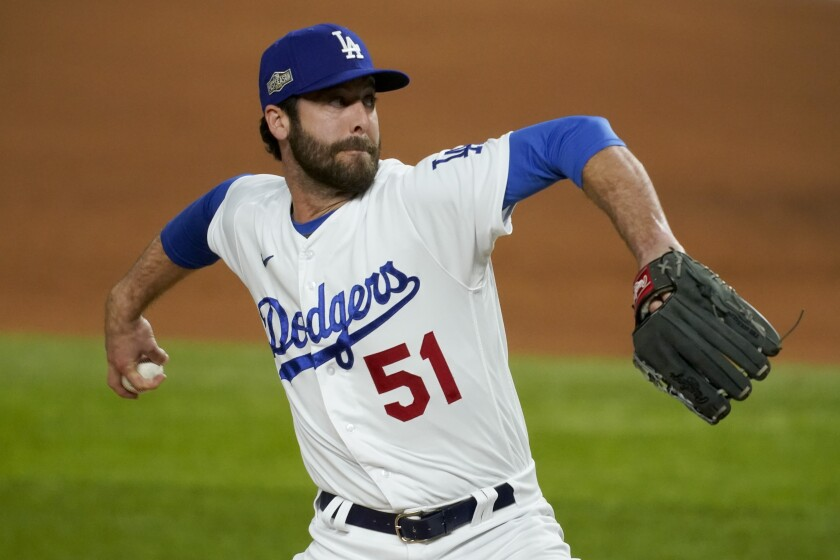 Dodgers relief pitcher Dylan Floro throws against the Atlanta Braves during the NLCS in Arlington, Texas.
