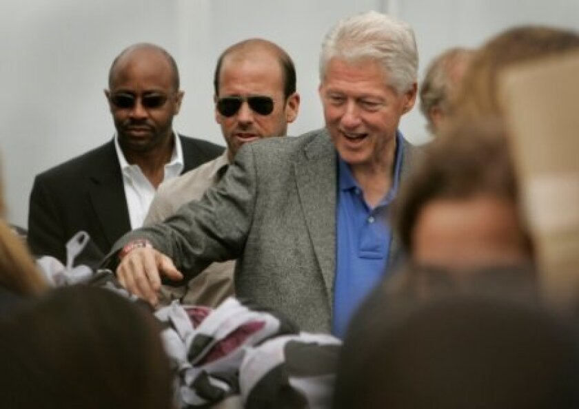 Former President Bill Clinton was helping some 1,000 students distribute food at the San Diego Food Bank on Sunday.