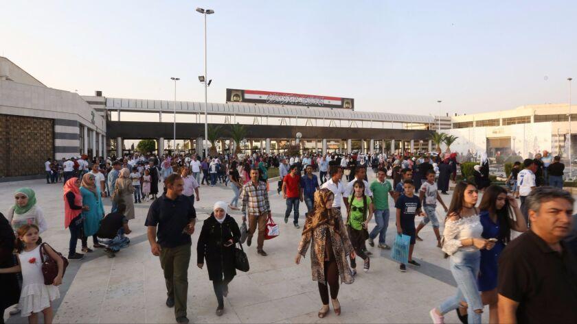 People visit the Damascus International Fair on Aug. 20.