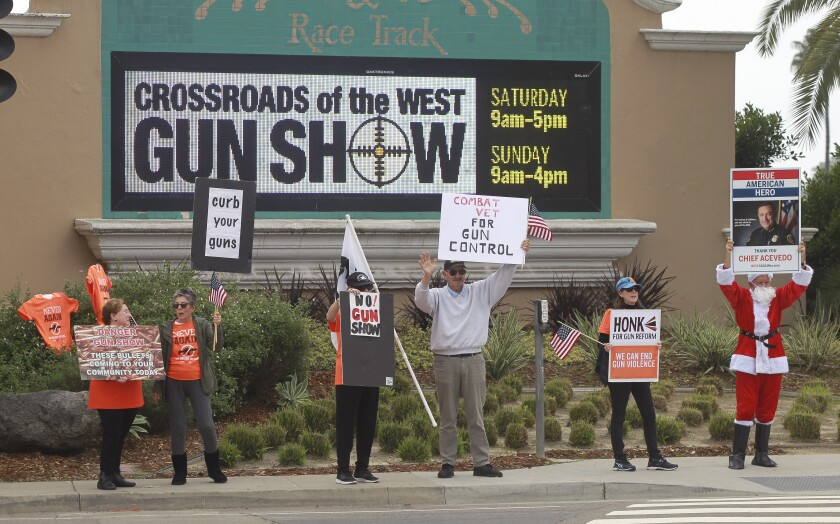Protesters demonstrate outside the Crossroads of the West Gun Show at the Del Mar Fairgrounds in 2019.