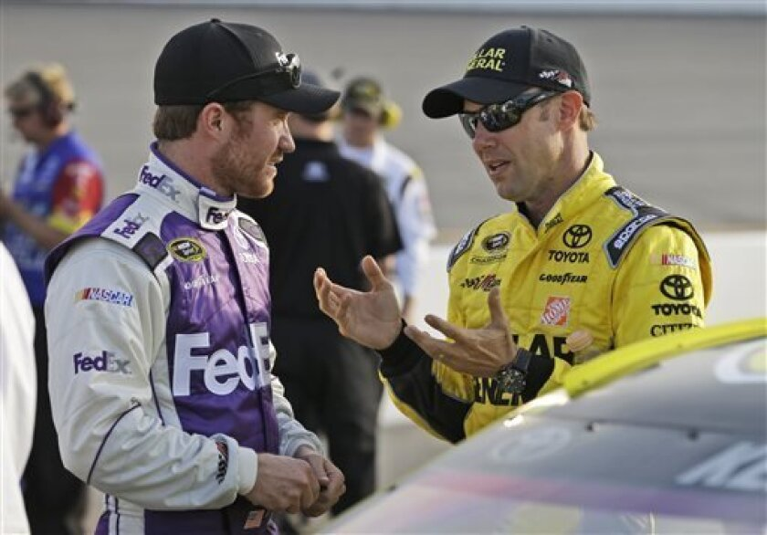 Drivers, Matt Kenseth, right, and Brian Vickers talk during qualifying for Saturday's NASCAR Sprint Cup series auto race at Richmond International Raceway in Richmond, Va., Friday April 26, 2013. (AP Photo/Steve Helber)