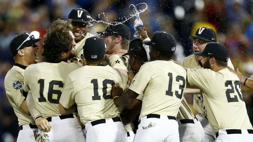 Vanderbilt players celebrate after defeating Michigan in Game 3 of the NCAA College World Series bas