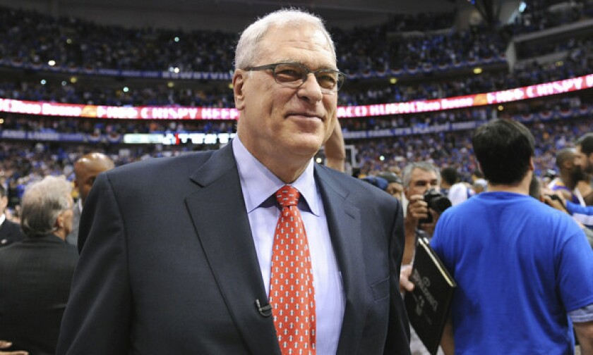 Phil Jackson walks off the court following his final game as Lakers coach in May 2011. Are the Lakers really going to let Jackson go to the New York Knicks?