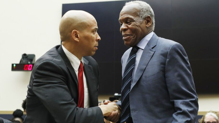 Sen. Cory Booker, left, and actor Danny Glover testified June 19 before a House Judiciary panel.