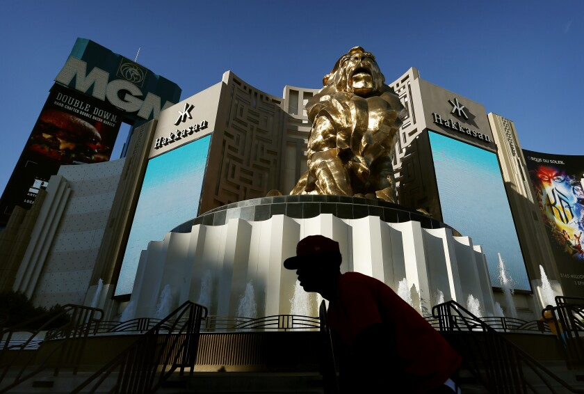 A man bikes past the MGM Grand in Las Vegas