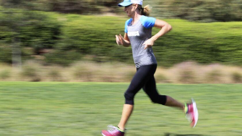 Triathlete Julie Moss training at Alga Norte Park in Carlsbad. photo by Bill Wechter
