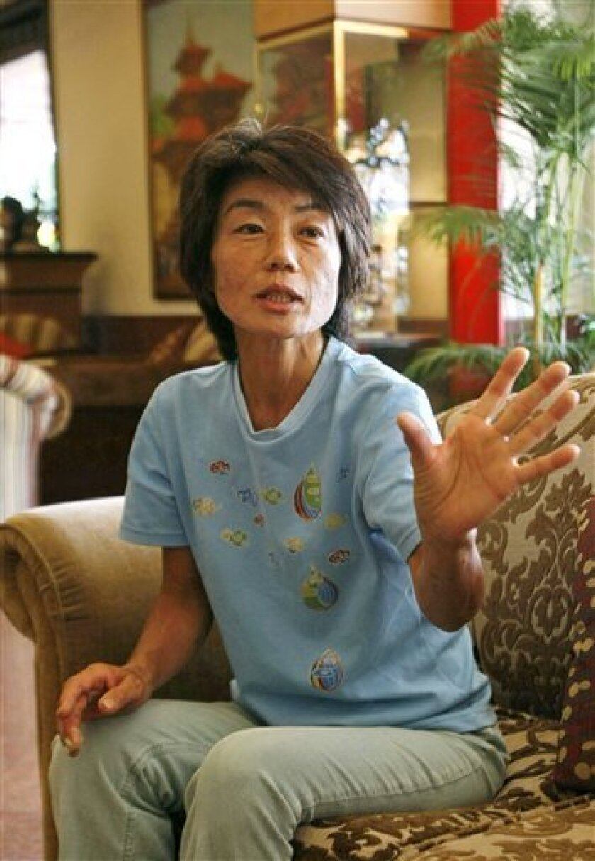 After surviving alone for nearly two weeks lost in the mountains of Nepal, Japanese woman Makiko Iwafuchi, 49, of Tokyo, gestures as she speaks to reporters in Katmandu, Nepal, Friday, June, 10, 2011. Iwafuchi left her hotel for a short stroll and then could not find her way back, going missing for 13 days in the mountainous region of Rashuwa district, Nepal, and said on Friday that she survived by eating grass, drinking river water, taking shelter in small caves and praying.(AP Photo/Binod Joshi)