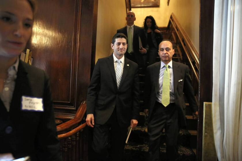 Rep. Paul Ryan (R-Wis.), left, made a joint appearance Monday at the City Club of Chicago with Rep. Luis Gutierrez (D-Ill.), a leading backer of immigration reform.