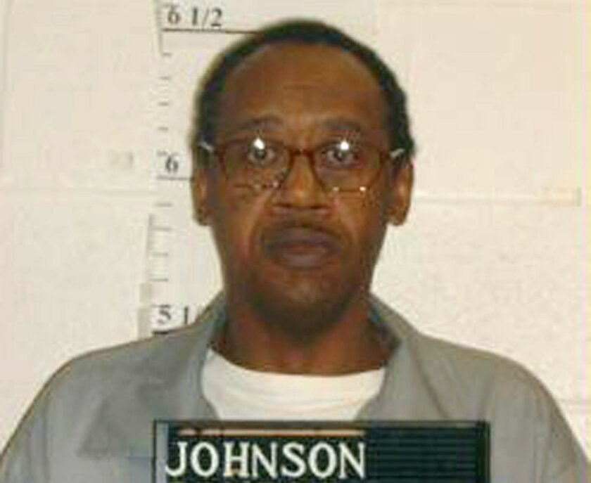 This photo provided by the Missouri Department of Corrections shows Ernest Johnson. Johnson was convicted of killing three Columbia, Mo., convenience store workers with a claw hammer in 1994. (Missouri Department of Corrections via AP)