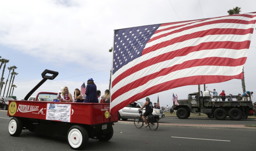 The City of Fountain Valley made a red wagon float featuring a large American flag for Surf City's Fourth of July Parade along Pacific Coast Highway in Huntington Beach on Thursday.