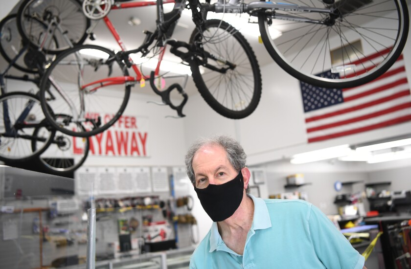 A man in a mask at a pawn shop